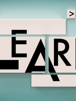 The word 'learn' on canvases